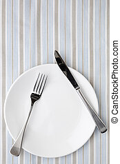 Place Setting on Striped Tablecloth - Place setting on...