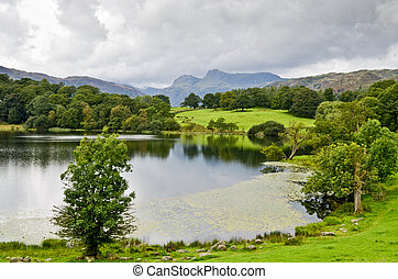 Loughrigg Tarn and the Langdale Pikes in the English Lake...