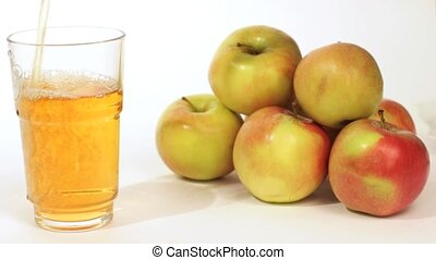 Pouring Apple Juice into Glass and - Male hand takes sweet...
