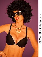 Sneering woman with black afro hairstyle