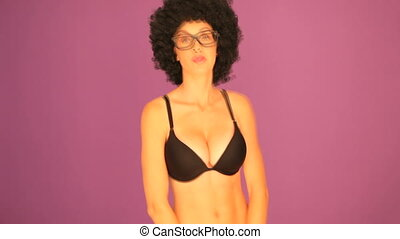 Woman with afro pulling faces - Cheeky sexy busty woman with...
