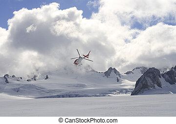 Flying helicopter on glacier - Helicopter flying above Franz...