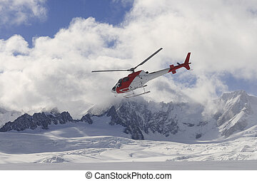 Flying helicopter on glacier - Helicopter flying over Franz...
