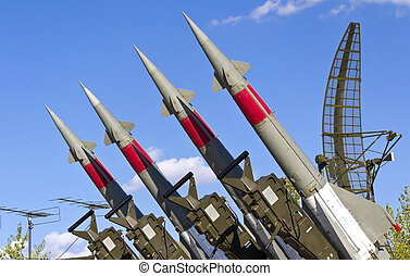 rockets of a surface-to-air missile system are aimed in the...