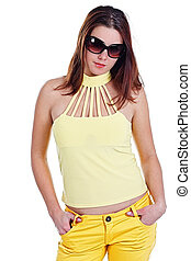 Young woman in yellow with sunglasses