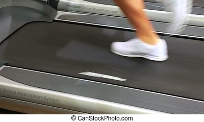 Feet running on treadmill in gym