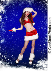 Winter portrait of beautiful sexy girl wearing santa claus clothes