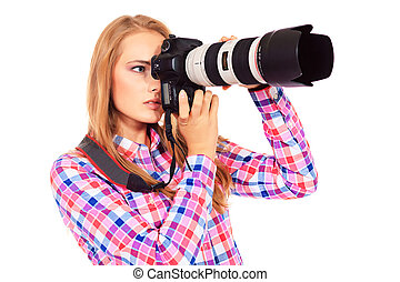 paparazzo - Pretty young woman taking pictures on the camera...