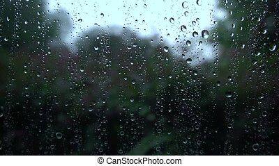 Rainy window pane - Lens is focused on the raindrops that...