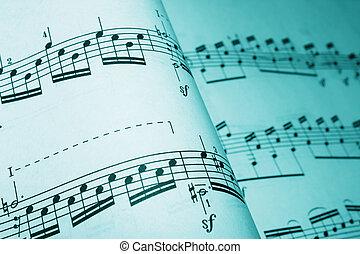 sheet music in a cyan tone