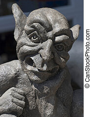 Gargoyle - A statue of a gargoyle shown from the shoulders...