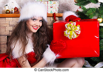 Happy smiling woman present  Christmas gift surprise