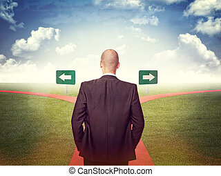 decision - standing man and 2 way street