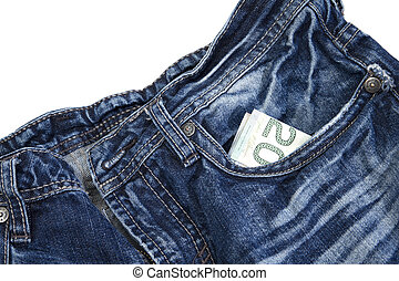 pocket money - closeup of blue jeans with canadian money in...