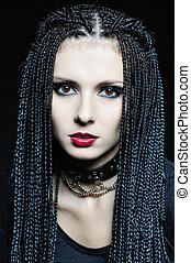 Beautiful woman in gothic shape with african pigtails