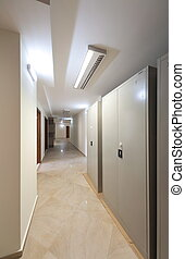 Corridor with door and lamps