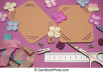 scrapbooking - hand made scrapbooking album and tools lying...