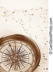 Compass and map close up shot