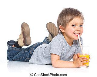 Little boy drinking orange juice - Happy little boy drinking...