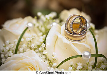 wedding rings and roses arrangements