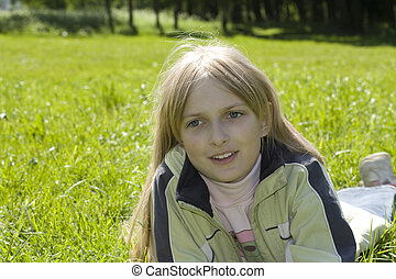 Young smiling girl on mea