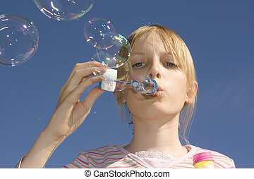 Girl blowing blow bubbles