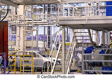 cars in a row at car plant - cars in a row on conveyor at...