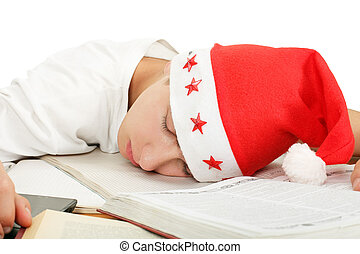 student sleep in santa's hat - tired student in santa's hat...