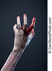 Bloody zombie hand, extreme body-art
