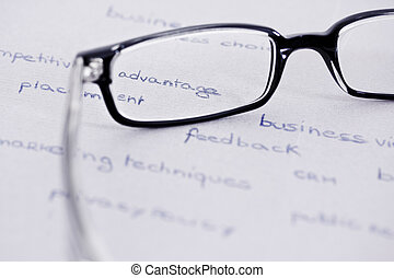 glasses with focus on competitive advantage - business words...