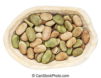 fava (broad) bean - dried fava (broad) bean in a rustic wood...