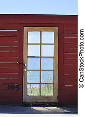 Ocean view - Old glass door of unfinished building with...