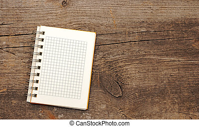 Open blank note book on grunge wood . With copy space