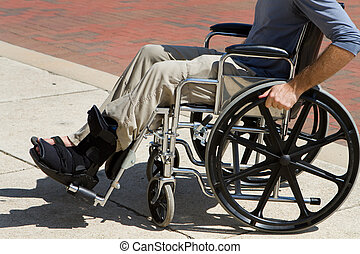 Injured Man Wheelchair - Injured man with a broken foot...