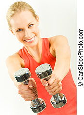 Barbells in hands - Photo of young woman showing two metal...