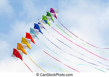 Colored kite, happy composition - Colored kites in a blue...