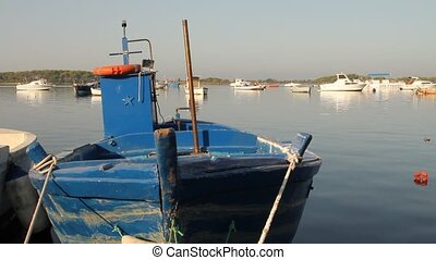 Pan of docked fishing boats in a small village in the south...