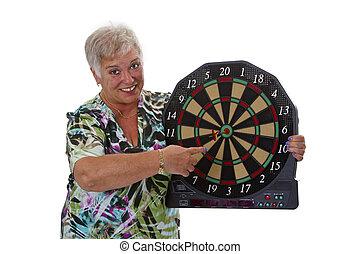 Female senior with darts