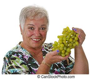 Female senior with grapes