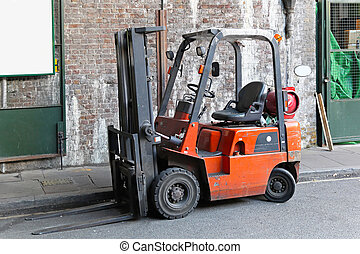 Forklift - Gas powered small forklift in industrial...