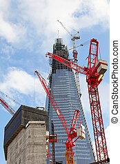 The Shard construction - Red cranes at construction site of...