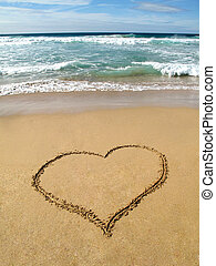 Heart on the sand - Waves breaking on shore and a heart...