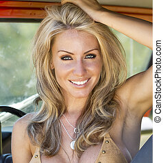 Blonde Model With Car - Beautiful blonde model posing with a...