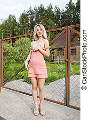 Nude girl in the village. - Young woman with bare tits...