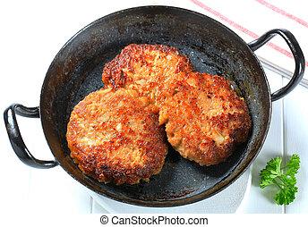 Pan fried vegetable burgers in a skillet