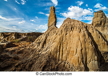 A White Stone Pillar in a Desert - A stone pillar in a...