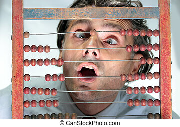 man with abacus - surprised man looking at an old abucus