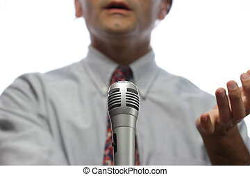 orator - microphone  and out of focus Public speaker