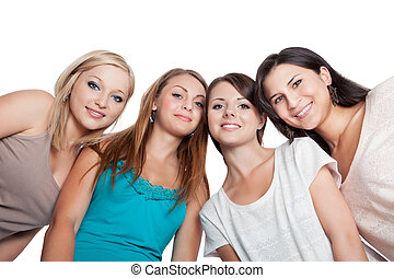 Four young woman looking down - Four attractive young woman...