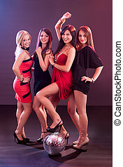 Four smiling girls with a disco ball